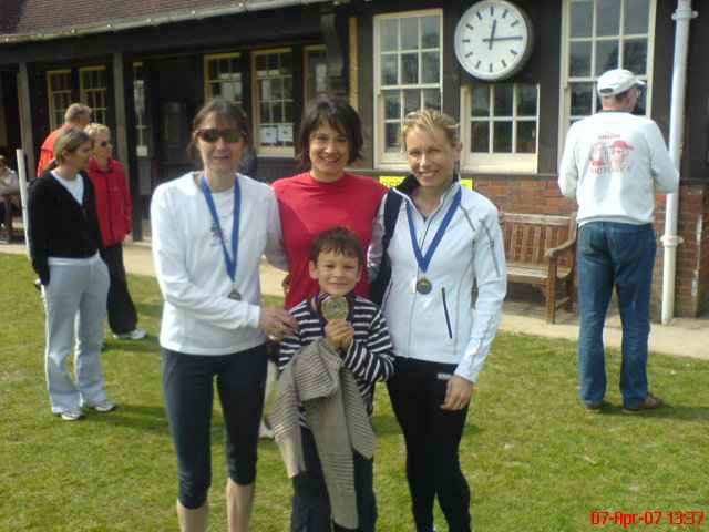 Caroline Julie and Louise collecting medals